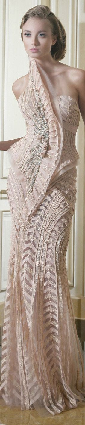 Gown of blush pink with accents of silver gray.