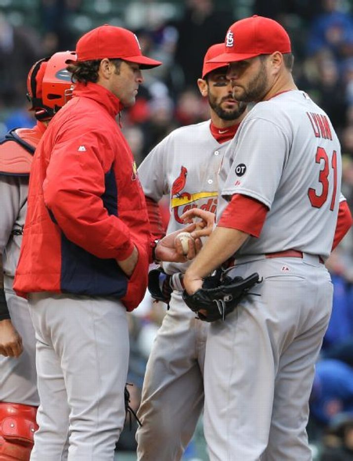 manager Mike Matheny takes the ball from starting pitcher Lance Lynn during the seventh inning of game against the Chicago Cubs. Cards lost 2-0. 4-08-15