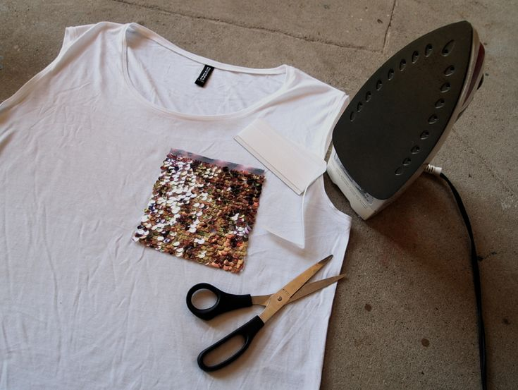 DIY Sequin Pocket Shirt. An old shirt or tank, sequin fabric, iron on hem tape, scissors, and an iron!