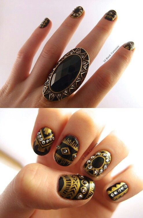 Black and gold tribal nails with rhinestones perfect for fall.