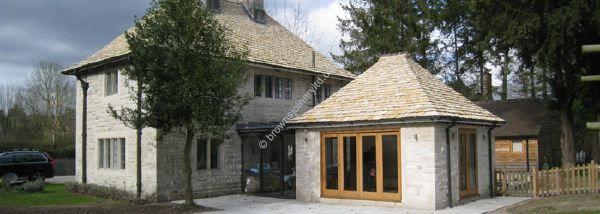Glazed link with bi-fold sliding timber doors www.brownsjoineryltd.co.uk