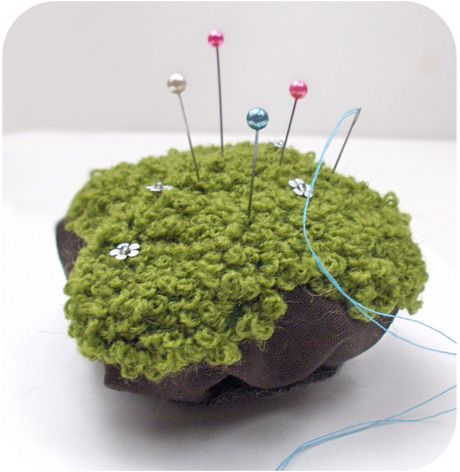 """adorable """"moss on a rock"""" pincushion.  i love keykalou's patterns and have made loads of purses from them.  the """"moss"""" is just lots of little french knots. :)"""