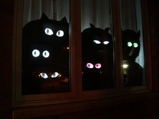 homemade creepy window decorations with eyes that follow you