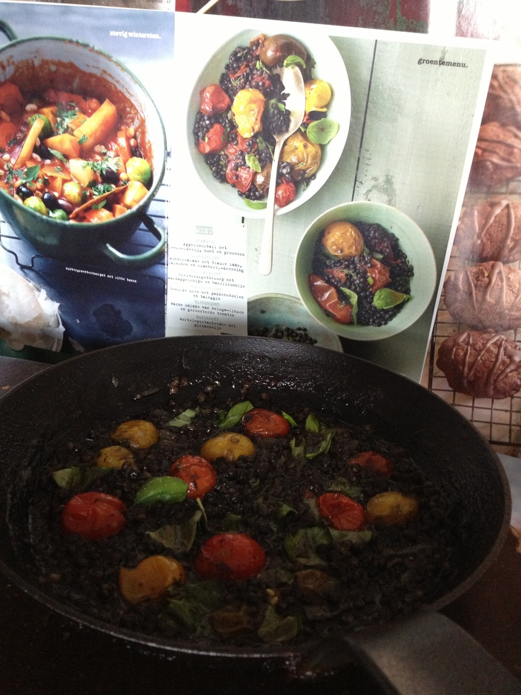 Beluga lentils with roasted tomatoes and basil.