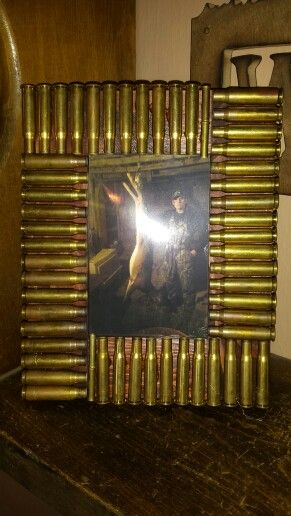 Bullet casing picture frame. I bought a 4x6 frame from the craft section at walmart and we had some stain left over from doing our bathrooms. Then I had my husband save his shells for me. Add a little hot glue and done!
