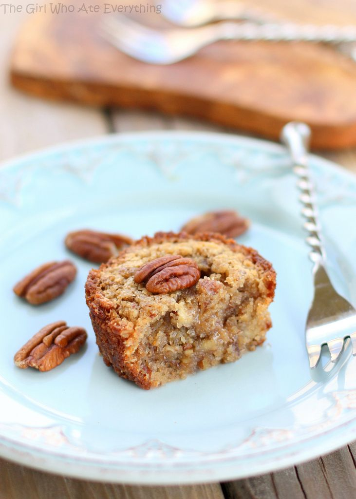 These Pecan Pie Muffins are a mix between a pie and a muffin. They have a muffin texture with a soft gooey inside like a pecan pie. the-girl-who-ate-everything.com