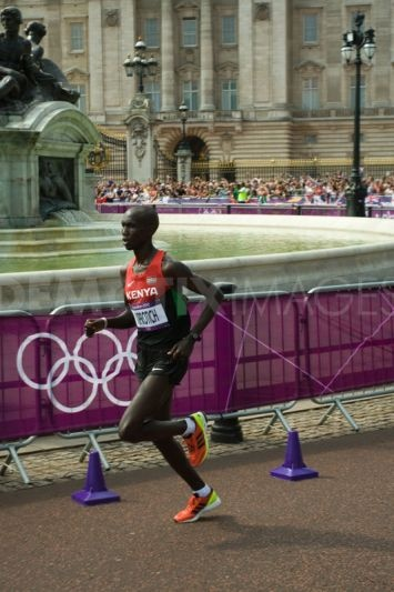 Bronze Medalist Wilson Kiprotich of Kenya passes the 10 mile mark in the London 2012 Olympic Marathon.