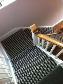 Black and gray stripes carpet for white staircase