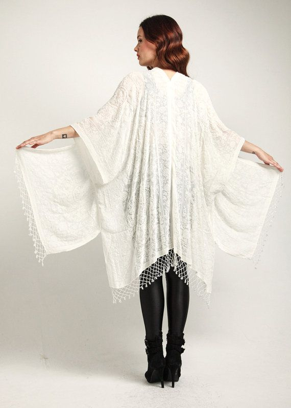 C R Y S T A L - L A C E  Drape yourself in this dreamy ethereal burnout velvet kimono. Featuring glistening crystal white ornate medalion lace velvet across sheer nude burnout, finished with shimmering metallic beading throughout and dripping in artic white beaded fishnet fringe tassels.  M e a s u r e m e n t s  SIZE.............................. FREE SIZE  LENGTH ....................... 38  All measurements in inches.  S H I P P I N G  International orders are shipped priority mail via…