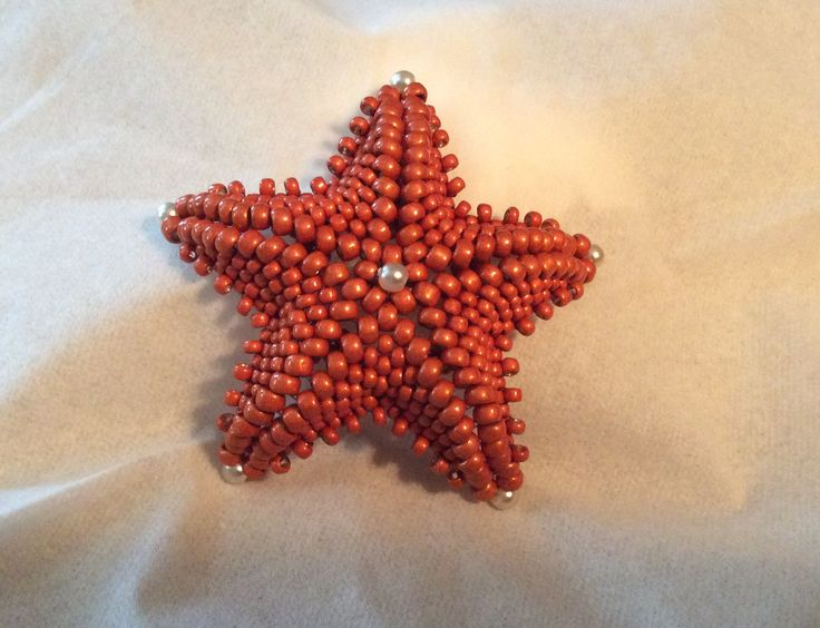 Starfish Pendant -made with size 8 & 11 seed beads and 3mm pearls. Learned to make this at Bead & Button 2014. The teacher/designer is Diane Dennis