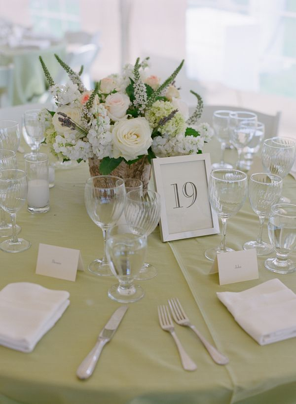 Round table inspiration, soft green linen, rustic floral centerpiece.  Photo by Carrie Patterson.