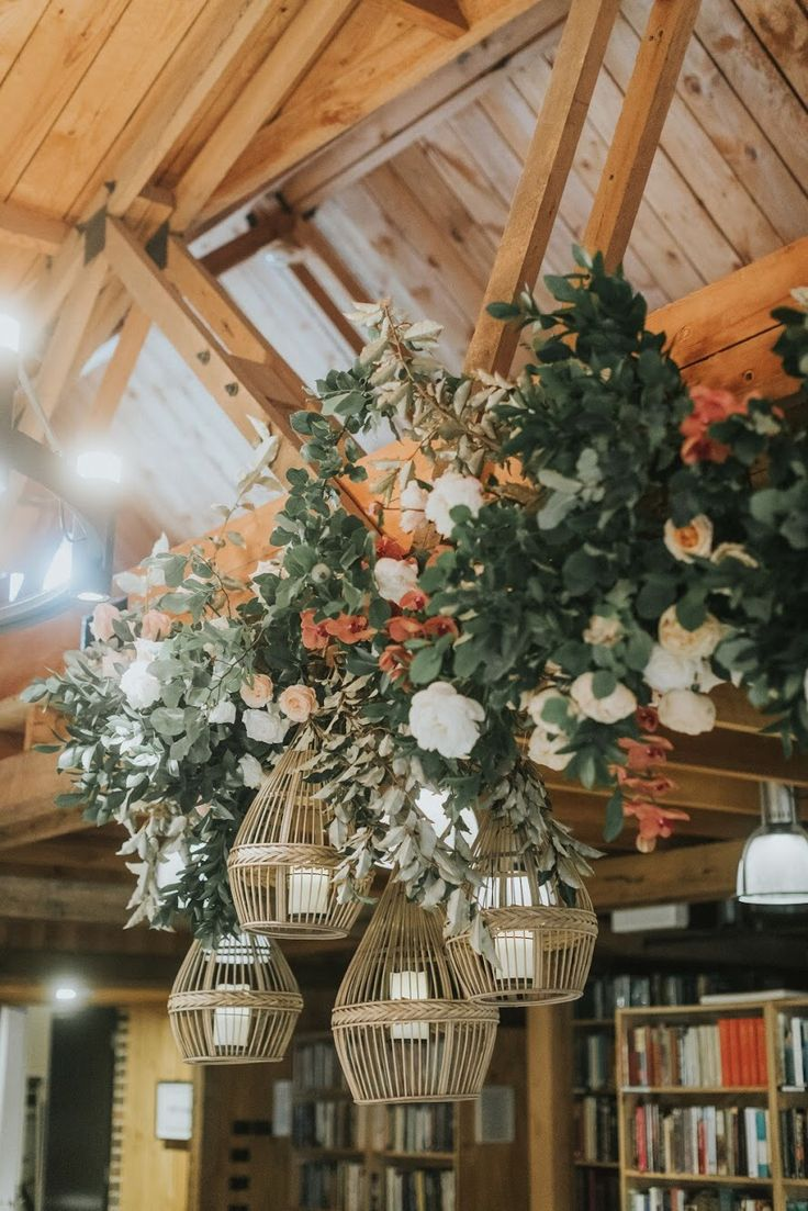 Ceiling floral and lanterns by EmmaBlake Floral / Photography by Jonathan David / Venue Bendooley Book Barn