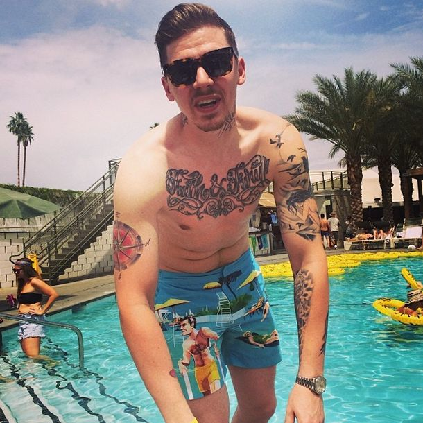 Professor Green poolside in his OBs.