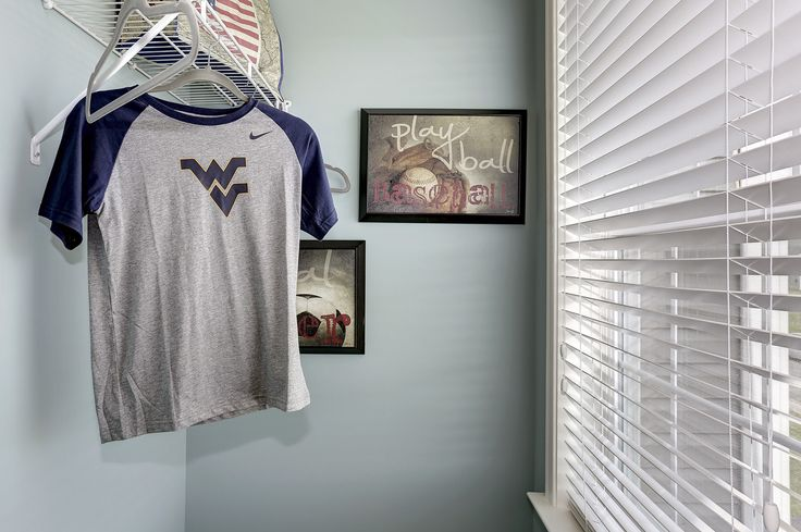 Cute way to decorate a boy's closet. Blue walls, basefall frames, natural window lighting. From the Newbury II model at Stonebrook Village by Dan Ryan Builders. Home Style Ideas