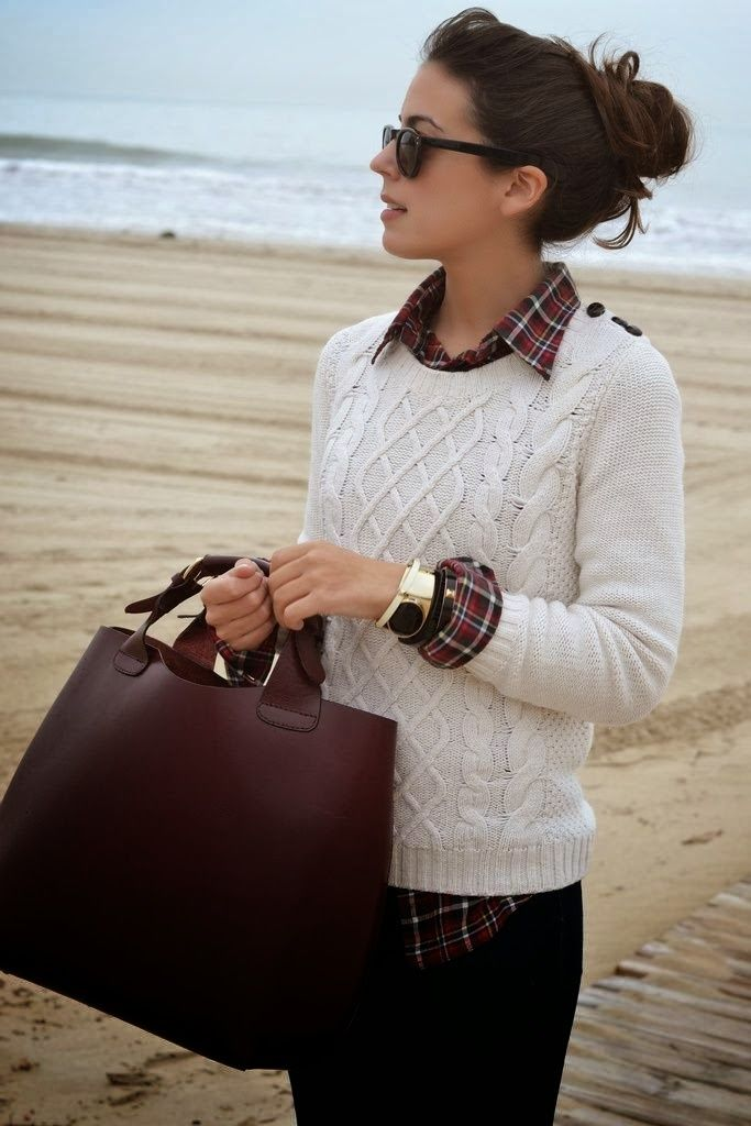 Stylish Classic Business Casual Women. White Sweater, Leather Handbag, Black Jeans and Accessories