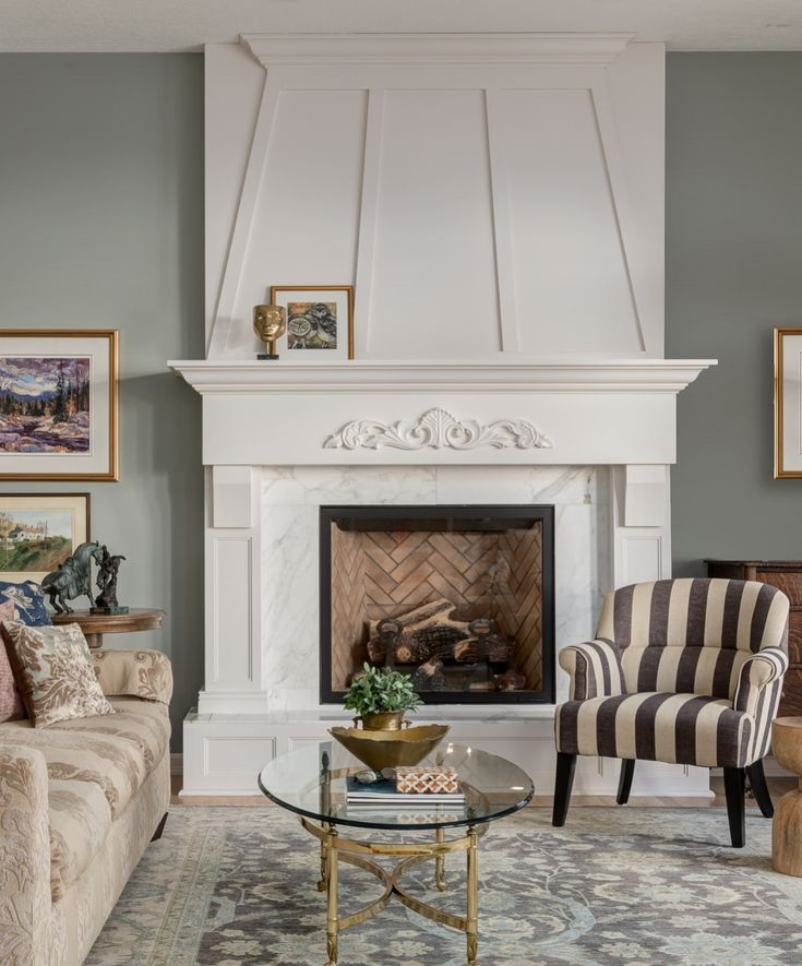 White English fireplace with andirons and herringbone laid brick
