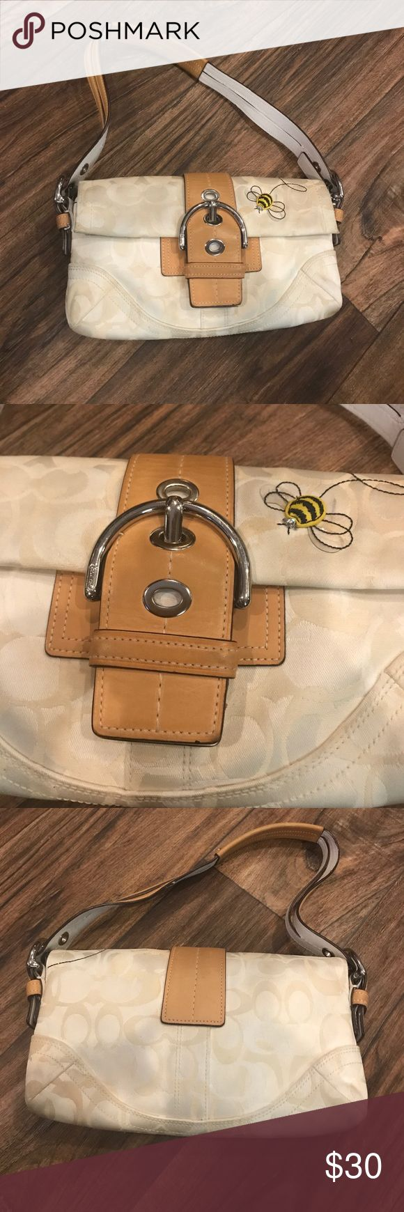 Off-white Coach mini Shoulder Bag with Bee detail Small Flap Off-white shoulder bag with bee  detail. Made with a classic Coach monogram print. Great for everyday  Has minor stain inside the handbag and by the bee detail but overall its in great condition. Coach Bags Mini Bags