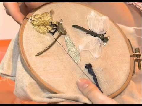 Dragonfly ribbon embroidery- tutorial is 100% NOT IN ENGLISH. But you can easily follow along and see what she's doing. She has a bunch of other great ribbon embroidery video tutorials too! Gosh I wanna try the tulip flower one next! :-)