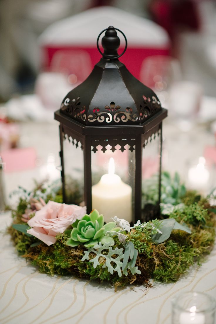 Romantic Candle Lanterns Were Surrounded By Green And Light Pink Wreaths Of Roses Succulents Rustic Lantern CenterpiecesSucculent Wedding