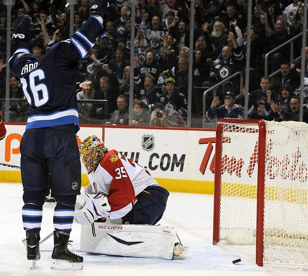 Florida Panthers at Winnipeg Jets Game W 7-2- 04/11/2013 Andrew Ladd #16 of Winnipeg raises his arms in celebration as the puck lays behind goaltender Jacob Markstrom #35 of Florida for a first period goalat MTS Centre.  (Photo by Lance Thomson/NHLI via Getty Images)