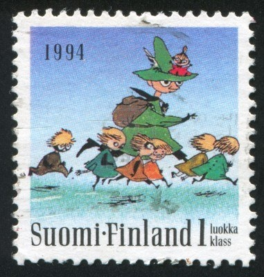FINLAND - CIRCA 1994: stamp printed by Finland, shows Moomin characters, Seven running, circa 1994 Stock Photo