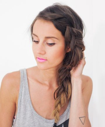 Messy Side Braid: Start w/ unwashed hair. Create side part. Divide off front bang section. Separate bang section into 3 equal parts, and start French braiding them down, keeping braid as close to front of head as possible. Continue downwards, adding small sections of hair until reach neck. Divide the remaining hair into 3 equal sections, and create a standard braid until the end. Secure with an elastic. Loosen by carefully pulling sections of hair outwards, all the way up and down the braid