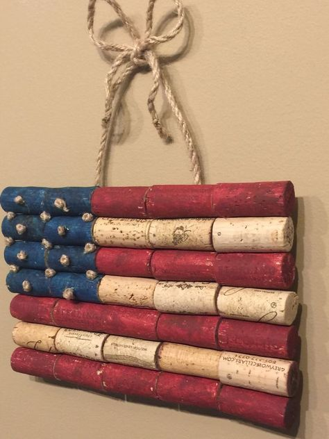 Wine Cork American Flag ... using a thin plywood or luan for the backing or even cardboard.  Paint your corks, then glue them onto the backing.  Use twine glued to the backing or drill two holes & thread it thru & tie knots in each end. It looks like the stars are twine knots ............... #DIY #corks #winecorks #cardboard #chipboard #plywood #luan #craftpaint #twine #decor #crafts