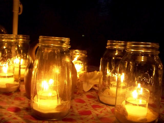 tealight inside mason jar for outdoor table decor = help prevent wind from blowing candles out