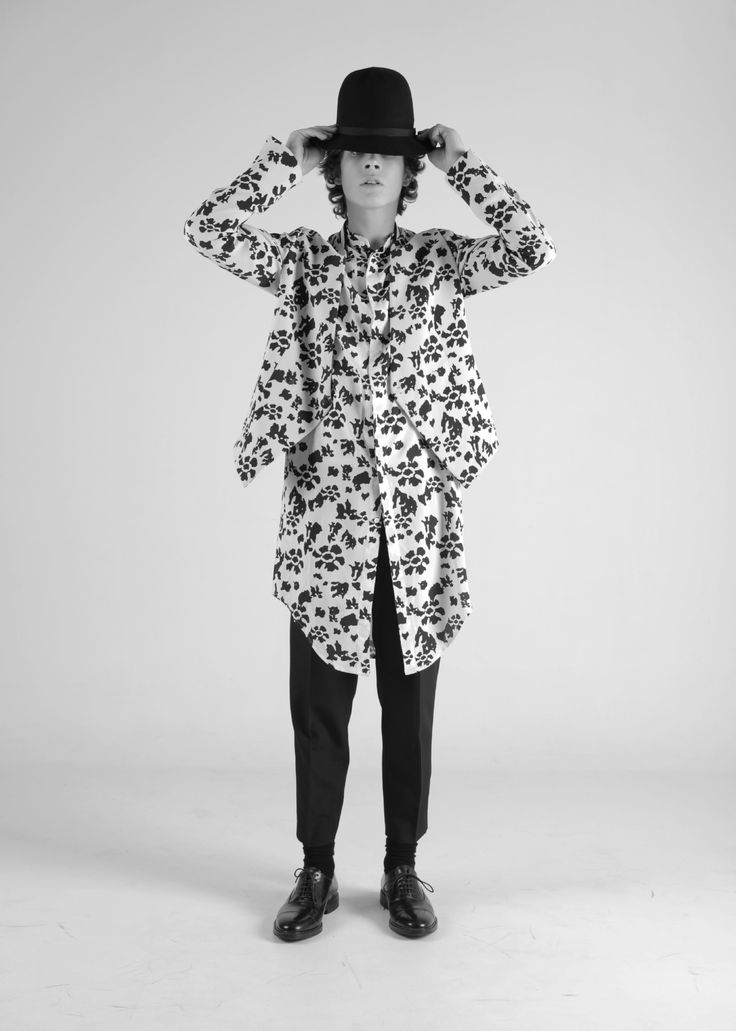 Matching white jacket and knee length shirt with black floral print, paired black suit trouser by 150 Yards Ahead