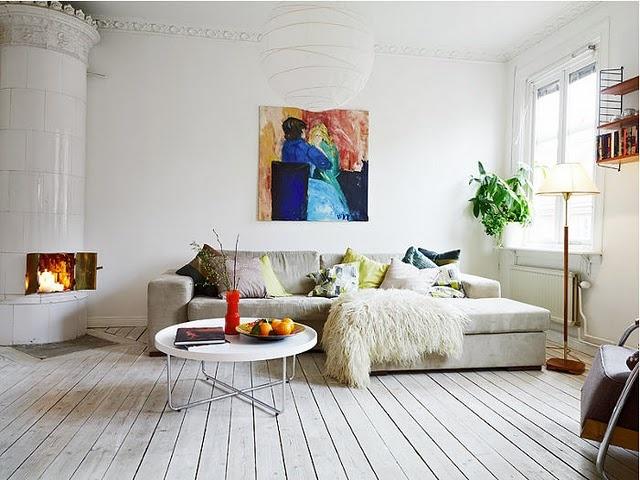 unreal living room, limed floor and tiled stove. In Gothenburg, Sweden.