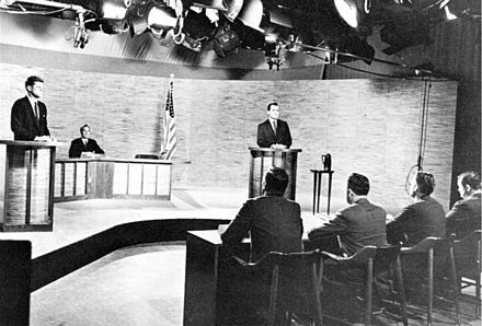 John F. Kennedy and Richard Nixon participate in the first televised presidential debate in Washington, D.C. in 1960.