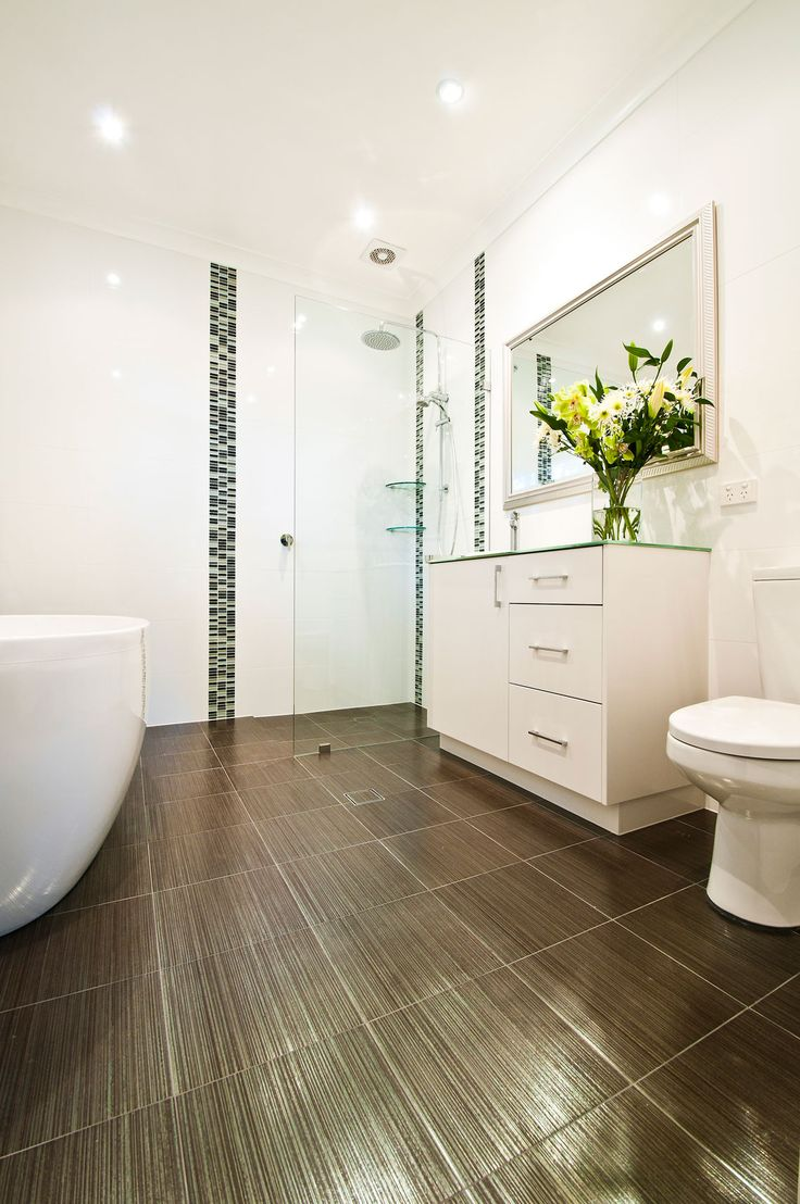 Sydney Bathrooms - LJT Bathrooms Renovations. Chocolate brown tiles, narrow stone wall feature, while walls and decor, plenty of light.