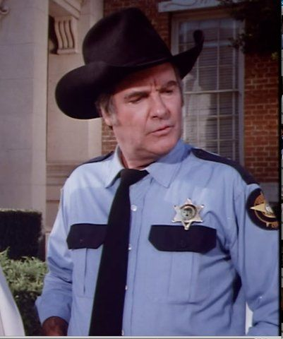 Sheriff Rosco P Coltrane portrayed by James Best from Dukes of Hazzard TV Series Season 3 wearing his blue sheriff uniform. - See this image on Photobucket.