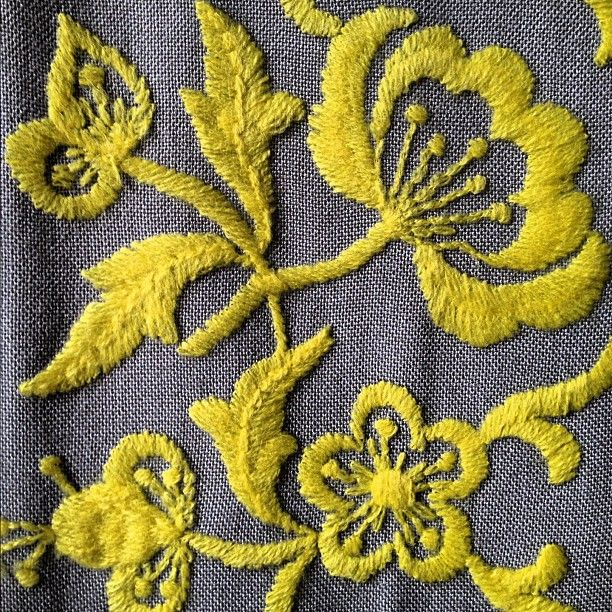 crewel  (this is actually very similar to one of our comforters, except in yellow rather than white)