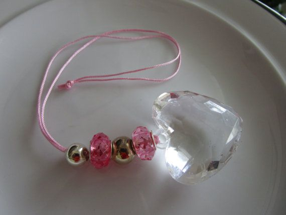 Clear glass heart pendant on a pink cord with by LeeliaDesigns