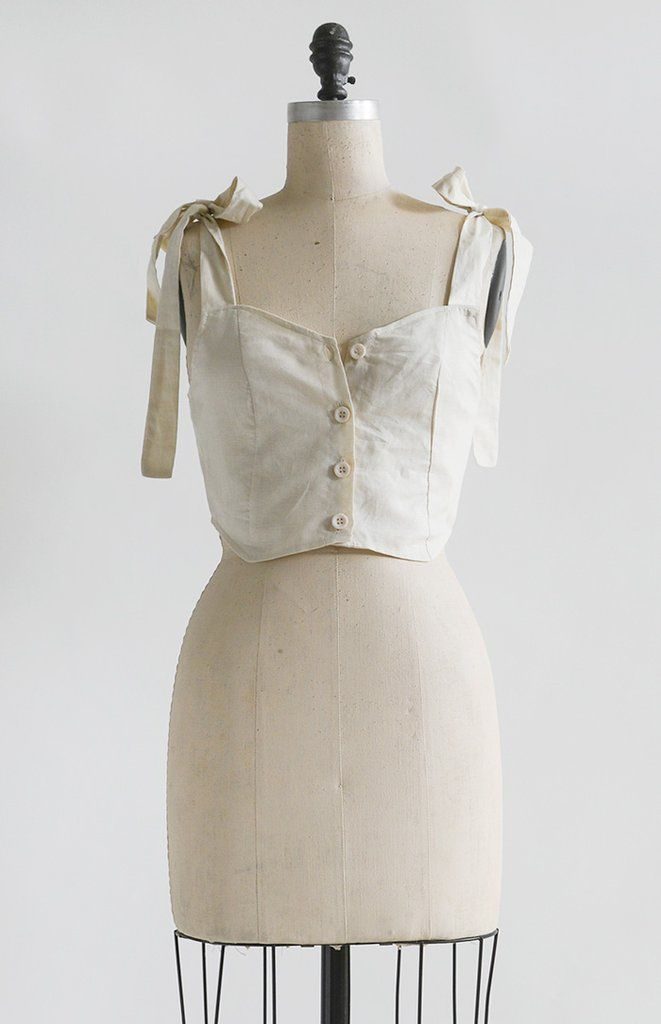 3e3816bf90ccca Feminine and romantic vintage inspired camisole top in lightweight linen  cotton in a soft warm white hue. This feminine blouse ties at the shoulders