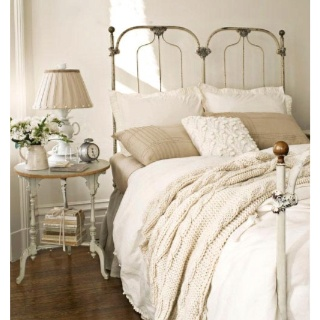 White, off white, tan. pillows, throws, comforter. currently collecting for our master...:)