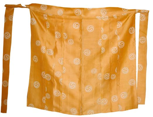 "A ""tomoe"" (huge comma design) motif ""mo-bakama"" from the Kamakura period. These were worn like skirts and are kind of like a way simpler version of normal hakama. They could be worn over kosode and The Costume Museum shows one being worn on this page: http://www.iz2.or.jp/english/fukusyoku/busou/9.htm 社団法人 京都染織文化協会/染織祭衣装"