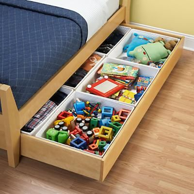 Bins that fit inside trundle bed to organize toys -- great for a small room.    I NEED THIS.