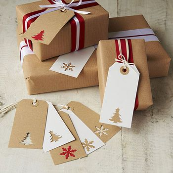 Gift tags - use the bits that you've cut out of some gift tags to stick on to different coloured gift tags