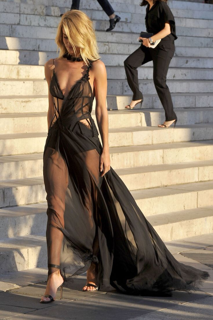 I really wish that this wasn't paired with heels. The dress itself is very interesting. It looks like it's for a delicate woman who's been through a war.