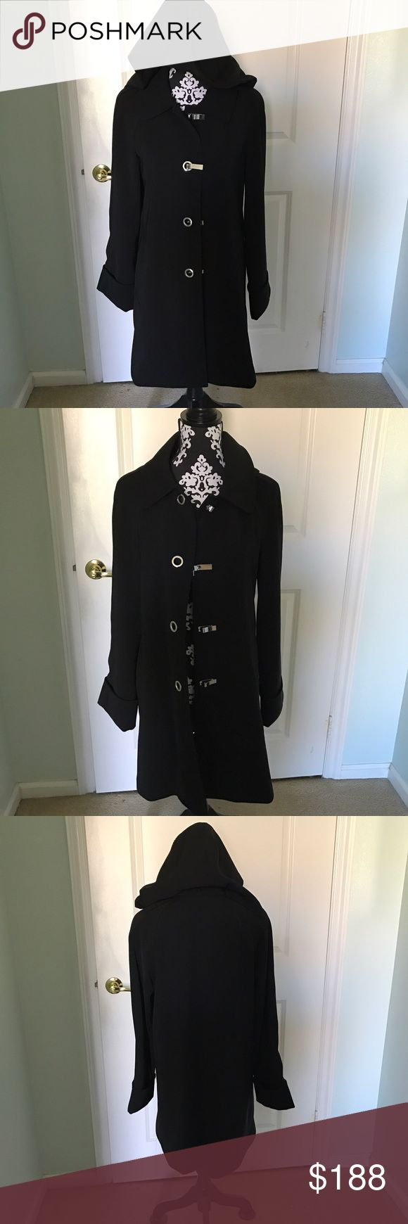 Michael Kors Hooded Trench coat NWOT Like new never worn. Has a buttoned detachable hood, silver hardware all buttons in tack and cuffed arms. No flaws Michael Kors Jackets & Coats Trench Coats