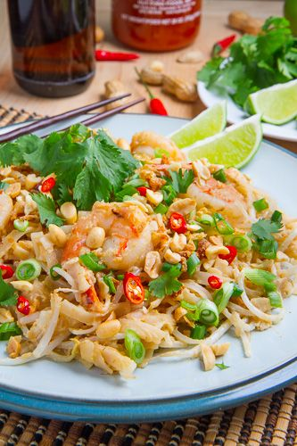 Spicy Peanut Pad Thai. 6 ounces rice noodles 1 tablespoon peanut oil 6 ounces shrimp, chicken or tofu 2 shallots, finely diced 2 cloves garlic, chopped 1/2 cup spicy peanut sauce 1 egg, lightly beaten 2 tablespoons roasted peanuts, chopped 1 cup bean sprouts 2 green onions, sliced 1/4 cup cilantro, chopped 1 lime lime cut into wedges