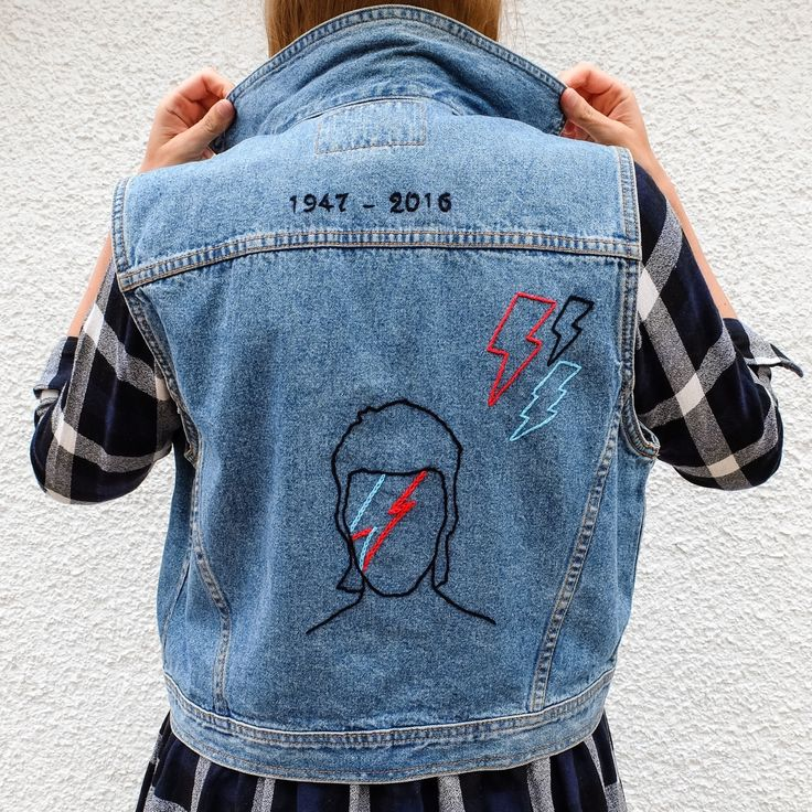 "Hand Embroidered Bowie Tribute Levi Vest. For all my ✨Star Children✨ this rad Levi Denim Vest is the ultimate tribute to my idol, David Bowie. Featuring the words ""Star Child"" on the front and iconic image of Bowie as Ziggy Stardust on the back, along with the date of his birth and death. Totally one of a kind custom piece of denim. Levi Ladies Size L - fits UK 10-14 depending on the desired fit. All embroidery is stitched by hand, by me. If you want something totally custom made just for…"