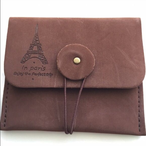 """Paris Themed Pouch Small, faux suede pouch features Eiffel Tower design above inscription, and elastic band closure. Rich brown color exterior. Approximately 4"""" high x 4.5"""" across. Image 4 shows pouch on legal size envelope. This is a small pouch, please note dimensions. Brand new without tags. No trades, no holding, no offsite payment. Accessories"""