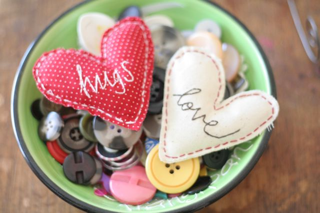 Happy Valentines Day.. Quick fabric hearts with a magnet slipped inside to turn them into fridge magnet gifts:)