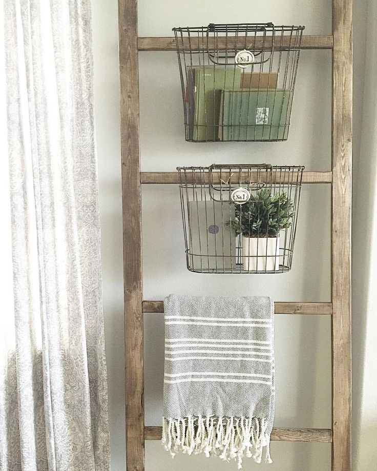 """Regan Mauck on Instagram: """"Hi there!! Last night I decided to add some baskets to my blanket ladder! What do y'all think!? I love it! If you want to build one just like this you can find the """"how-to"""" on my blog! Link in bio. Also if you haven't played #storybookhome yet, we would love to see your books! sharing for #whatsinmybasketwednesday #woodsandwhiteswednesday #myneutralnestwednesday"""""""