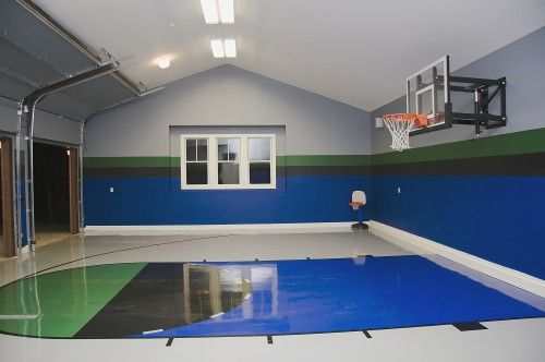 By day, an indoor basketball court, by night a garage. But whose garage is that clean?!
