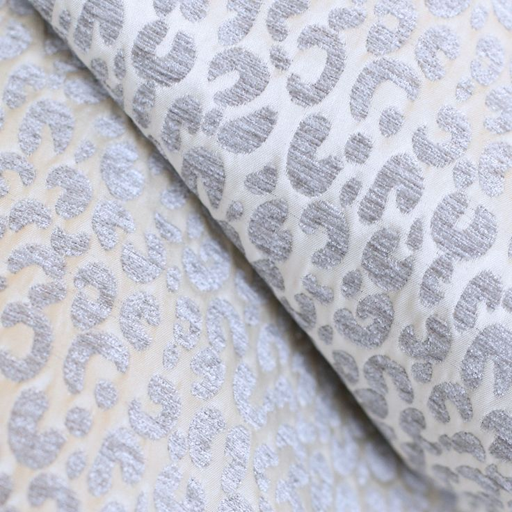 A pretty leopard print fabric in a soft chenille velvet (silver grey) on a soft, pale champagne background.Suitable for medium to heavy upholstery, decorative pillows, seat cushions and other home decor projects.Content: 100% PolyesterWidth: 57