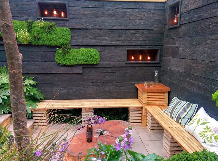 Wood panels and plants growing up the walls - ideal home show